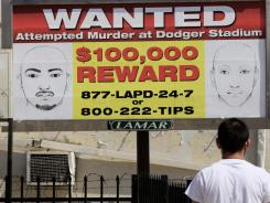 "A ""wanted' poster for two the suspects who assaulted Bryan Stow is posted on a billboard in Los Angeles."