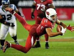 Cardinals WR Larry Fitzgerald caught 80 passes in 2011.
