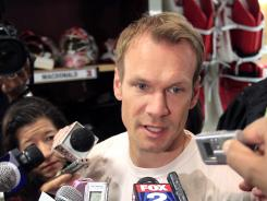 Detroit Red Wings defenseman Nicklas Lidstrom talks to reporters at the Joe Louis Arena after his team was ousted from the playoffs.
