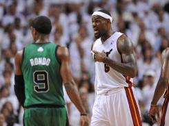 Miami Heat small forward LeBron James argues a call during the game against the Boston Celtics in Game 2 on Wednesday at Miami.