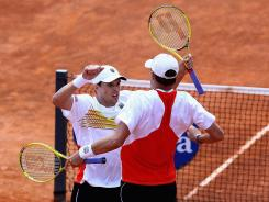 Bob Bryan and Mike Bryan and their famous chest bump.