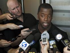Kordell Stewart talks with reporters as he talks about officially closing his playing career by retiring as a Pittsburgh Steeler on Wednesday.