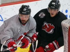 New Jersey Devils left wing Ilya Kovalchuk, left, and defenseman Anton Volchenkov take part in practice Tuesday.