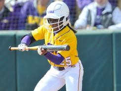 LSU outfielder Simone Heyward, who missed nearly a quarter of the season with a broken hand, said she connected on the three-run double that propelled the Tigers to the Women's College World Series with her eyes closed.