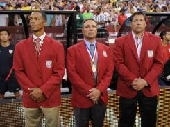 Newly elected into the National Soccer Hall of Fame, from left to right, Desmond Armstrong, Tony DiCicco and Tony Meola stand on the sidelines before an exhibition game between Brazil and the United States.