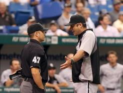 Chicago White Sox manager Robin Ventura talks with umpire Mark Wegner after starting pitcher Jose Quintana was ejected in the fourth inning. Before the ejection, Quintana had allowed just one hit.