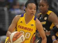Los Angeles Sparks guard Kristi Tolliver (20) dribbles the ball against the Tulsa Shock at the Staples Center on Tuesday.