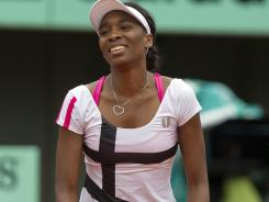 Venus Williams shows her frustration during her second-round loss to Agnieszka Radwanska on Wednesday at the French Open.