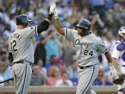 Dayan Viciedo, center, high-fives A.J. Pierzynski after his two-run homer helped the White Sox sweep the Cubs from May 17-19.