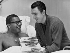 Basketball Hall of Famer Jack Twyman, right, who died Wednesday, was best known for his guardianship of former teammate Maurice Stokes, left.