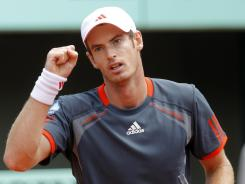 Andy Murray of Britain clenches his fist after rallying past Jarkko Nieminen of Finland in four sets in the second round of the French Open on Thursday.
