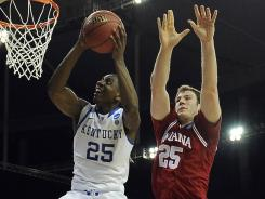 Kentucky guard Marquis Teague, scores in front of Indiana forward Tom Pritchard during the NCAA south regional semifinals, won by Kentucky 102-90, on March 23.