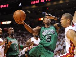 Boston Celtics point guard Rajon Rondo shoots against the Miami Heat during the first half in Game 2 on Wednesday. Rondo had 44 points but the Celtics fell to the Heat.