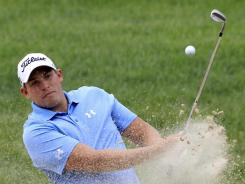 Scott Stallings, blasting out of a bunker on No. 14, shot a 6-under 66 to take the first-round lead Thursday at the Memorial.