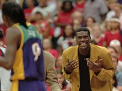 Orlando Woolridge, as the Los Angeles Sparks' coach in this 1999 file photo, was pronounced dead in his parents' Mansfield, La., home Thursday night. He was 52.