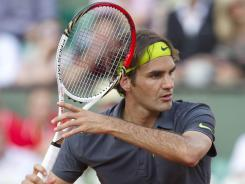 Roger Federer of Switzerland lines up a forehand during his third-round win Friday against Nicolas Mahut of France at the French Open.
