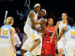 Chicago Sky players react after center Sylvia Fowles (34) scored a last-second field goal to put the Sky ahead with 0.2 seconds left. The Sky defeated the Washington Mystics 65-63.