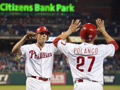 Philadelphia Phillies right fielder Hunter Pence, left, celebrates hitting a two-run home run with third baseman Placido Polanco in their game against the Miami Marlins.