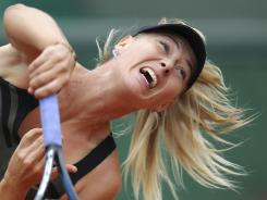 Maria Sharapova of Russia routs Ayumi Morita of Japan 6-1, 6-1 in her second-round match Friday at the French Open.