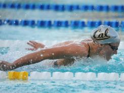 Dana Vollmer powers her way to victory in the 100-meter butterfly at the Santa Clara Grand Prix.