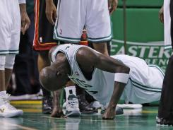 Boston Celtics forward Kevin Garnett does push-ups after being fouled during the second quarter against the Miami Heat in Game 3.