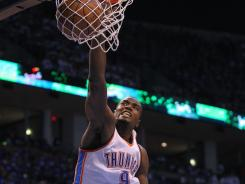 Thunder forward Serge Ibaka dunks for two of his 26 points Saturday against the Spurs in Game 4 of the Western Conference finals.