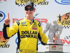 Joey Logano celebrates after winning the NASCAR Nationwide Series 5-hour Energy 200 at Dover International Speedway on Saturday in Dover, Del.