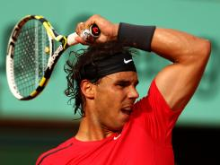 Rafael Nadal of Spain muscles past Eduardo Schwank of Argentina and into Round 4 of the French Open on Saturday in Paris. Nadal won 6-1, 6-3, 6-4.
