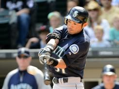 Mariners right fielder Ichiro Suzuki hits a home run against the White Sox on Saturday at U.S. Cellular Field. Seattle beat Chicago 10-8 in 12 innings.