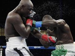 Antonio Tarver, left, and Lateef Kayode, exchange punches in the ninth round of their fight Saturday, which ended in a draw.