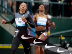 The USA's Allyson Felix defeats Carmelita Jeter to win the women's 200 meters in 22.23 seconds at the Prefontaine Classic on Saturday.
