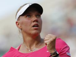Kaia Kanepi of Estonia ousts former No. 1 Caroline Wozniacki of Denmark in the third round Saturday.