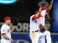 The Angels celebrate a 3-2 win against the Rangers on Saturday.