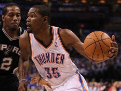 Thunder forward Kevin Durant drives past Spurs forward Kawhi Leonard in Game 4 of the Western Conference finals. Durant scored 36 points in a 109-103 Oklahoma City home win.