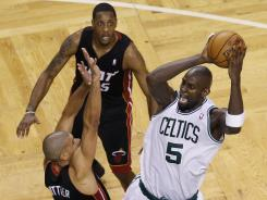 Celtics center Kevin Garnett shoots against Heat forward Shane Battier in Game 4 of the Eastern Conference finals.