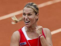 Dominika Cibulkova of Slovakia celebrates her fourth-round victory against top-seeded Victoria Azarenka of Belarus at the French Open in Paris.