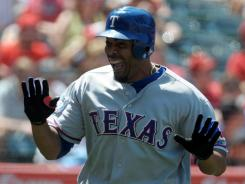 Nelson Cruz celebrates his seventh-inning homer that helped the Rangers beat the Angels.