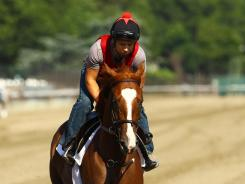 Dullahan is ridden by exercise rider Faustino Aguilar during a morning workout at Belmont Park on June 1.