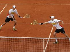 Bob, left, and Mike Bryan are on their way to the French Open quarterfinals.