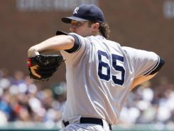 Yankees' Phil Hughes threw a complete game Sunday against the Tigers.