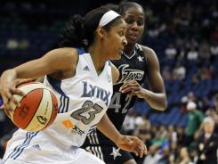 The Lynx's Maya Moore (23) drives against the Silver Stars' Shenise Johnson on Sunday. The Lynx won 83-79 and have yet to lose this season.