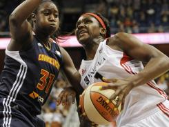 The Sun's Tina Charles, left, guards the Mystics' Crystal Langhorne in second half of the Sun's win on Sunday.