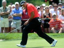 Tiger Woods reacts after missing an eagle putt on the seventh hole during the final round of the Memorial Tournament on Sunday.
