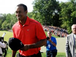 Tiger Woods walks off the 18th green after winning the Memorial Tournament at Muirfield Village Golf Club on Sunday.