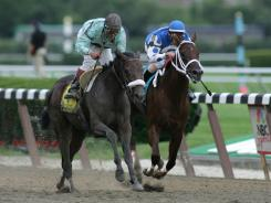 Eight years ago, Edgar Prado and Birdstone, left, spoiled the Triple Crown bid of Smarty Jones and jockey Stewart Elliott.