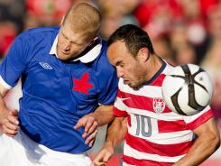 Canada's Andre Hainault, left, battles for the ball with United States' Landon Donovan during first-half action in Sunday's friendly in Toronto.