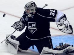 Los Angeles Kings goalie Jonathan Quick stops a third-period shot on his way to a 22-save shutout Monday.