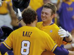 Raph Rhymes, right, celebrates his first-inning home run with Mason Katz during LSU's win over Oregon State.