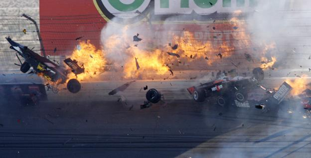 Drivers crash during the 2011 IndyCar season finale at Las Vegas Motor Speedway. Visible in the photo are the catchfence posts. Dan Wheldon died in the crash when his head slammed a fence post after his Dallara-Honda flew 325 feet.