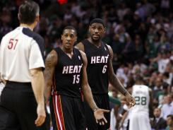 Miami's LeBron James (right) and Mario Chalmers react to a call during Game 4 of the Eastern Conference finals against Boston.